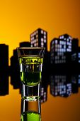 Absinthe Shot In Cityscape Setting