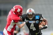 INNSBRUCK,  AUSTRIA - MAY 25 RB Talib Wise (#4 Raiders) runs with the ball during the EFL football g
