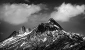 Black and white photo of majestic mountainous landscape, dramatic cloudy sky, beautiful panorama, ex