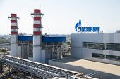 ADLER, RUSSIA - JUNE 26, 2013: Gazprom company logo on the roof of thermal power plant.