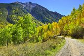 picture of colorado high country  - colorful mountains of Colorado and country road during foliage season - JPG