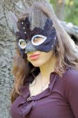 stock photo of catwomen  - Young beautiful caucasian girl wearing a cat mask.