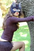 stock photo of catwomen  - Young beautiful caucasian girl wearing a cat mask - JPG