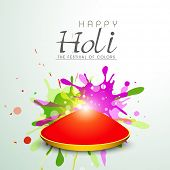 Indian festival Happy Holi celebrations concept with red colour on colours splash background.