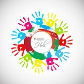 Indian festival Happy Holi celebrations concept with colourful hand prints impressions on grey background.