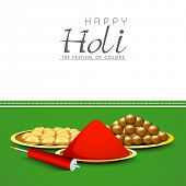 Indian festival Happy Holi background with preparation for festival colours, and sweets on green and grey background.
