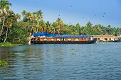 Landscape With Houseboat In Kerala Backwaters