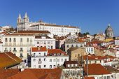 Sao Vicente de Fora Monastery and dome of the National Pantheon seen from Portas do Sol Belvedere with Alfama District rooftops. Lisbon, Portugal.