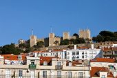 View of the Sao Jorge Castle from the Baixa (Downtown) District of Lisboa, Portugal. One of the land