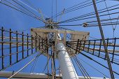 stock photo of yardarm  - Masts rigging and yardarms of 19th century sailing ship Old Mystic Seaport Connecticut - JPG