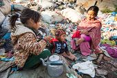 KATHMANDU, NEPAL - DEC 24: Unidentified child and his parents during lunch in break between working