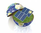 stock photo of courtesy  - one earth globe divided into two parts with a lawn and solar panels - JPG