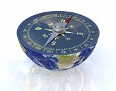 stock photo of courtesy  - one earth globe divided into two parts with a compass - JPG
