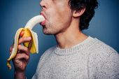 Young Man Eating Banana