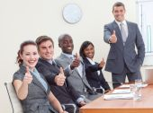 image of thumbs-up  - Businessteam with thumbs up after a presentation in office - JPG