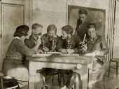 MOSCOW, USSR - CIRCA 1920s students-biologists conduct a scientific experiment.: An antique photo shows .