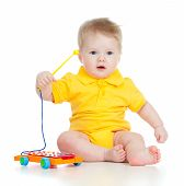 Funny Baby Playing Musical Toy. Isolated On White Background