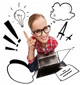 education, technology and internet concept - smiling teenage girl in black eyeglasses with laptop co