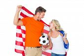 Excited football fan couple holding usa flag on white background