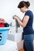 Young Housekeeper Washing The Clothes