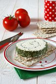 stock photo of collate  - ?old collation: Crisp bread, tomatoes and cheese with French Provencals herbs - JPG