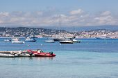Cannes: view from Lerins Island. Small and large yachts anchored in the bay. French Riviera, Europe.
