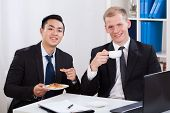 Men During Business Lunch In Office