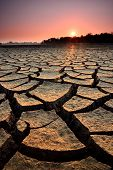 image of water shortage  - dry cracks in the land serious water shortages