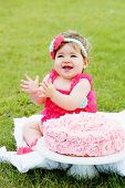 Pretty Birthday girl having cake outside