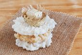 Coconut Candy Cocada With Wicker Hat On Sackcloth