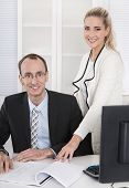 Successful Business Team: Smiling Man And Woman In Portrait In The Office.