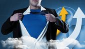 Businessman opening his shirt superhero style against digital blue background with arrows