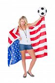 Pretty blonde football fan wearing usa flag on white background