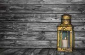 Old Rustic Golden Lantern On Wooden Old Shabby Background For Concepts.