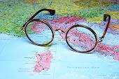 Glasses on a map of europe - Rome
