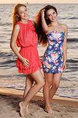 Summer, sea. Cute girls on the beach