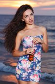 Summer, sea. Cute girl on the beach