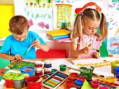 Happy children  boy and girl  painting.