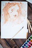 Picture of female painted by water-color and drawing equipment