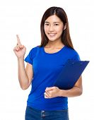 Asian woman with clipboard and finger point up