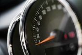 picture of car symbol  - Close up shot of a speedometer in a car.