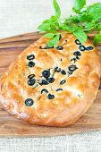 Fresh Italian Homemade Focaccia Bread With Rosemary And Olives. Indoors Closeup.