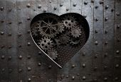heart hole in old metal with gears and cogs