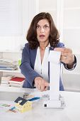 Shocked And Frustrated Business Woman Controlling Expenses.