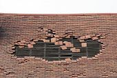 Damaged Roof With A Large Hole
