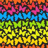 Seamless pattern with colorful rainbow butterflies