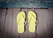Yellow Flip-flops On The Porch
