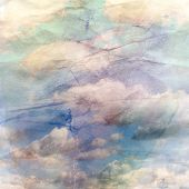 Old Crumpled Background With Clouds