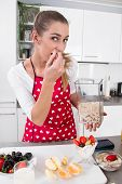 Young Woman Eating Yogurt With Fresh Fruits In The Morning.