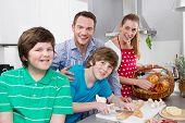 Happy Family In The Kitchen Preparing Breakfast On Sunday.